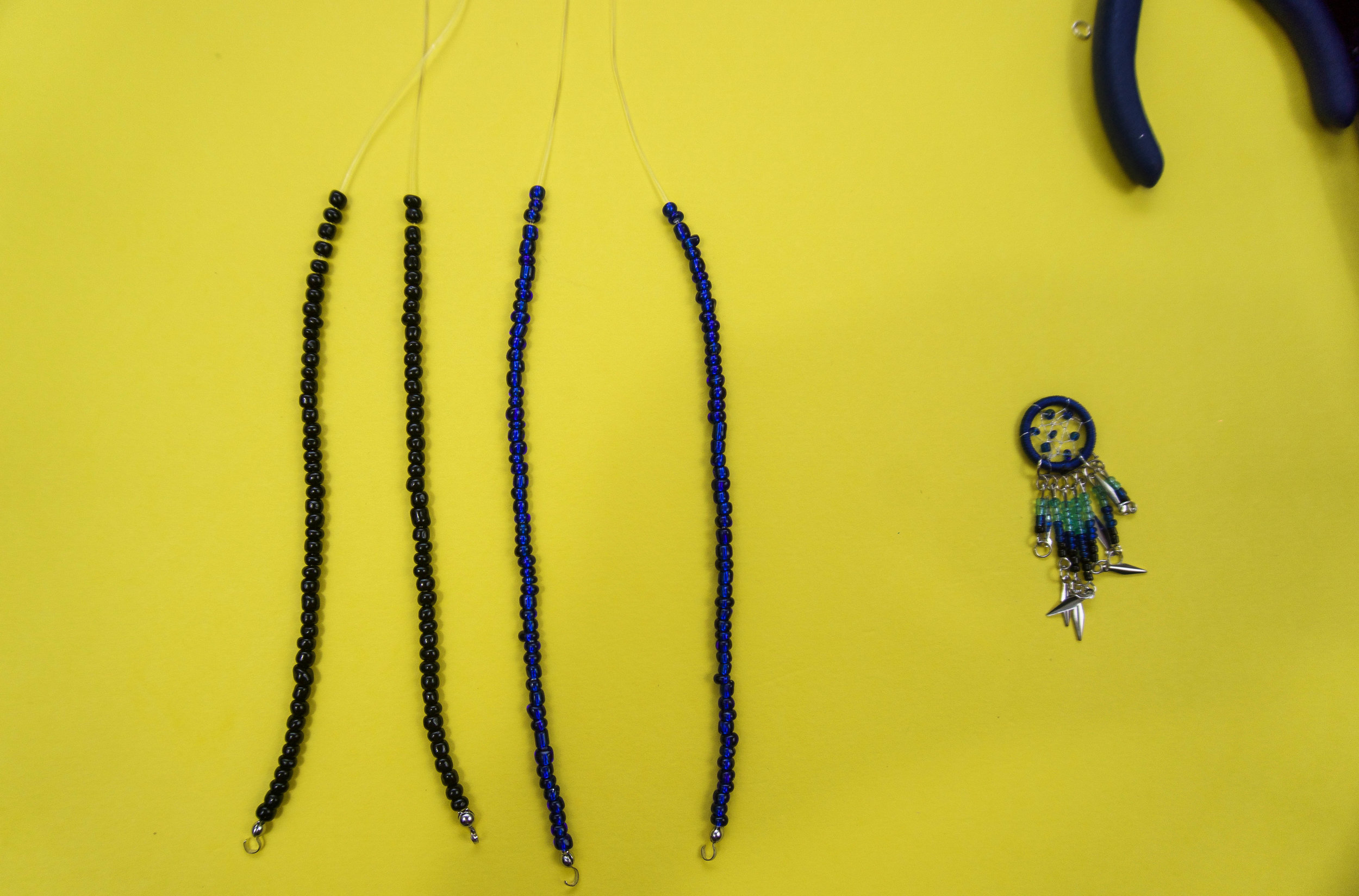 DIY choker necklace with a blue dreamcatcher pendant to wear with your outfit to Coachella Music festival. Cute for a boho chic look or even a hippie chick.