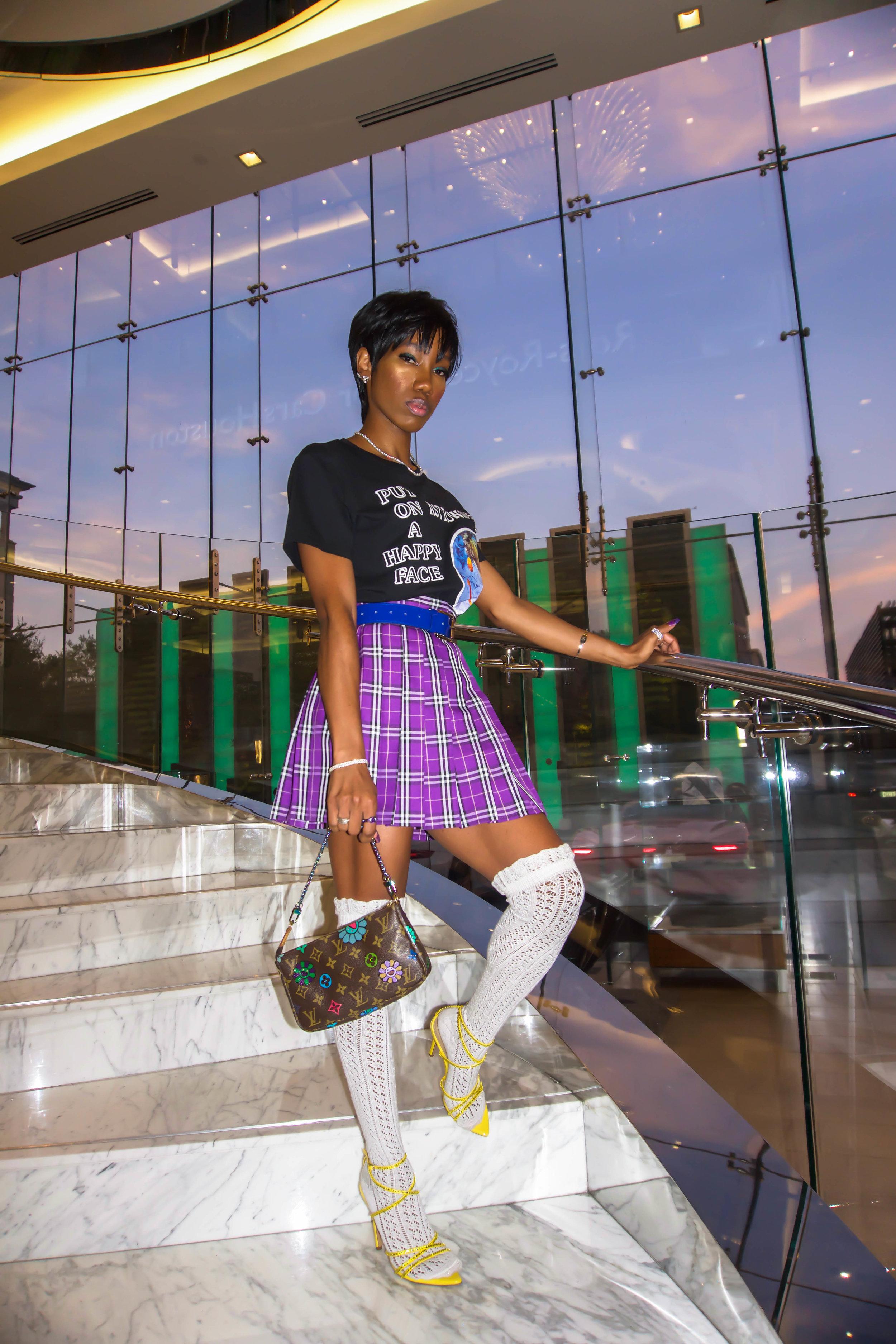 Top:   Astroworld Merch  //  Skirt:   Pink Plastic Babez  //  Bag:   Louis Vuitton x BTD  //  Shoes:   BTD