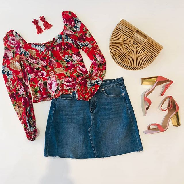 Annnnnndddd we're back! Red is a key colour this season, so in keeping with this I bring you some seasonal styling. The newest #keypiece @jeanswest denim skirt has been styled with a @forevernew_official red floral top, earrings and bag from @sussan and finishing off the look with colourful shoes from @rubishoes_anz. #getthelook #flatlaythenation