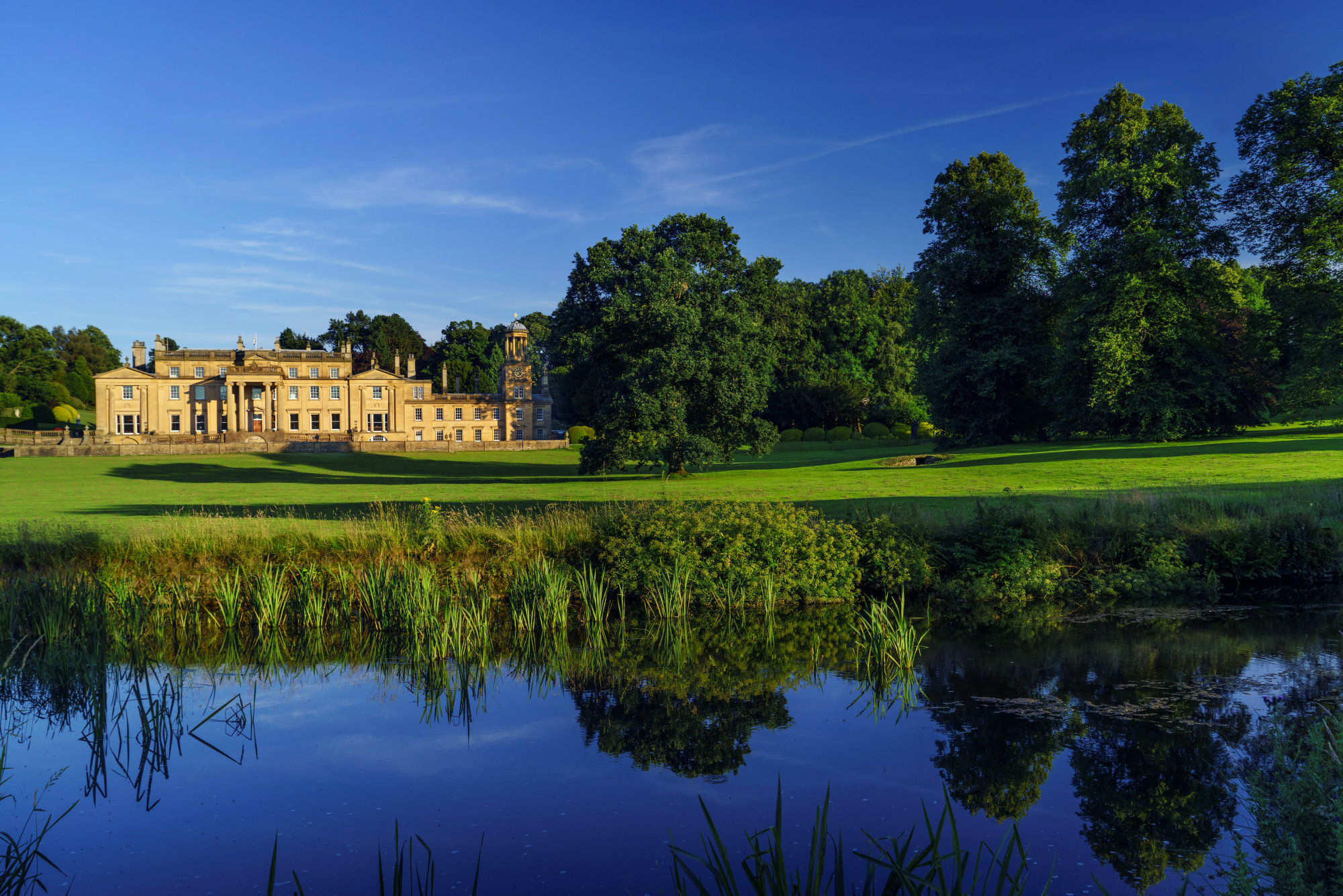 broughton-hall-front-blue-sky-reflection-water.jpg