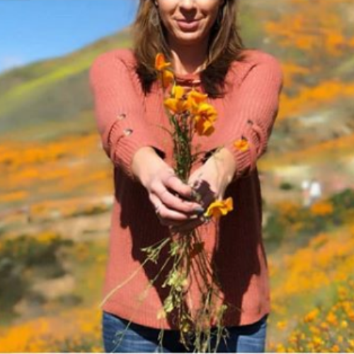 Influencer pulling poppies (1).png
