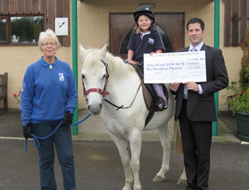 James McCreath, Director. Presenting a cheque to Avon Riding Centre for the Disabled