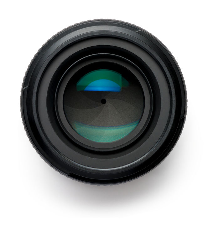 31760068 - 50mm camera lens on white