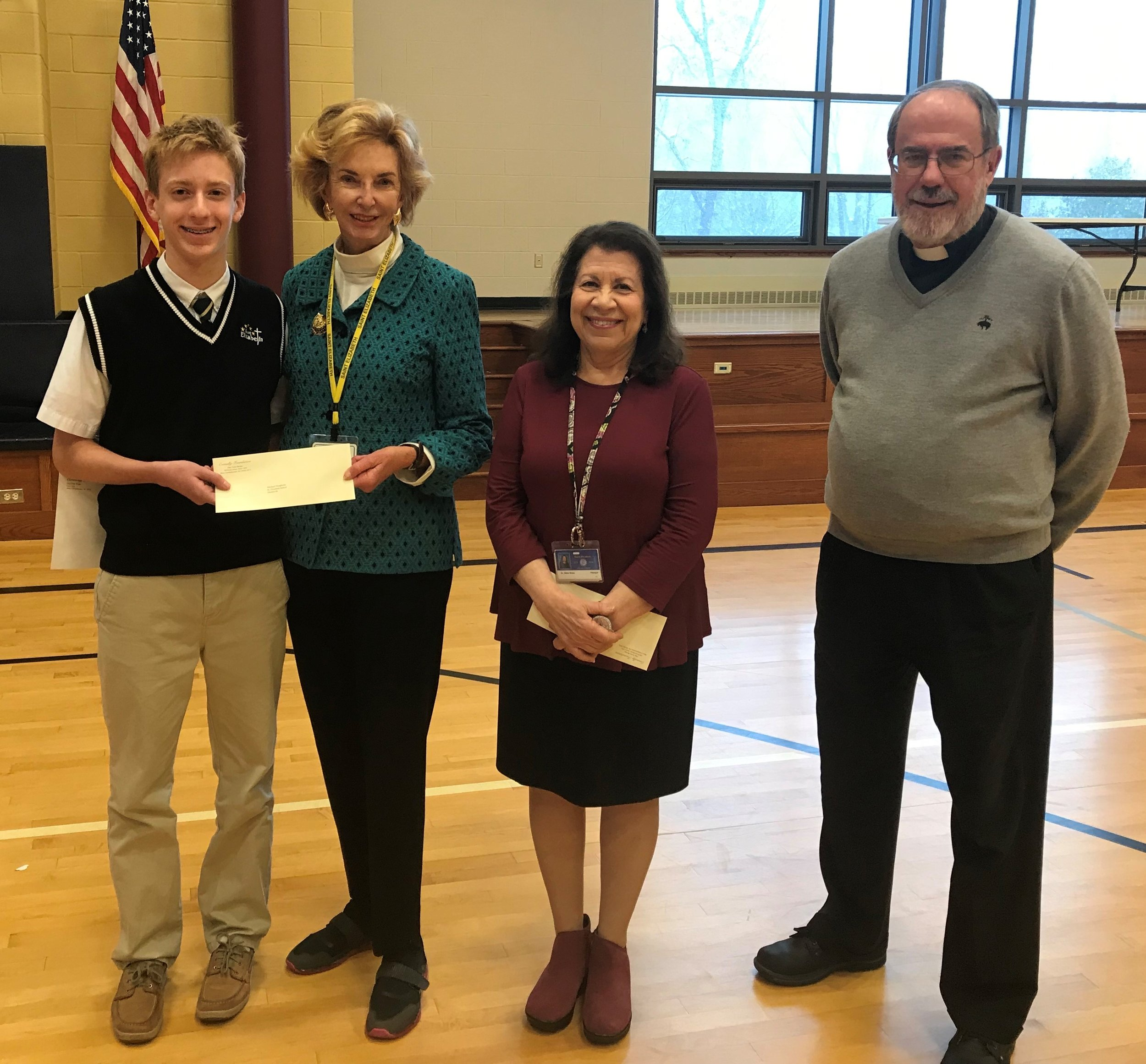 Class of 2019 Neumann Scholar Michael Dougherty (left), with Mrs. Josephine Mandeville, Chair of the Board of the Connelly Foundation, Dr. Diane Greco, Principal and Father Thomas M. Mullin, Pastor.