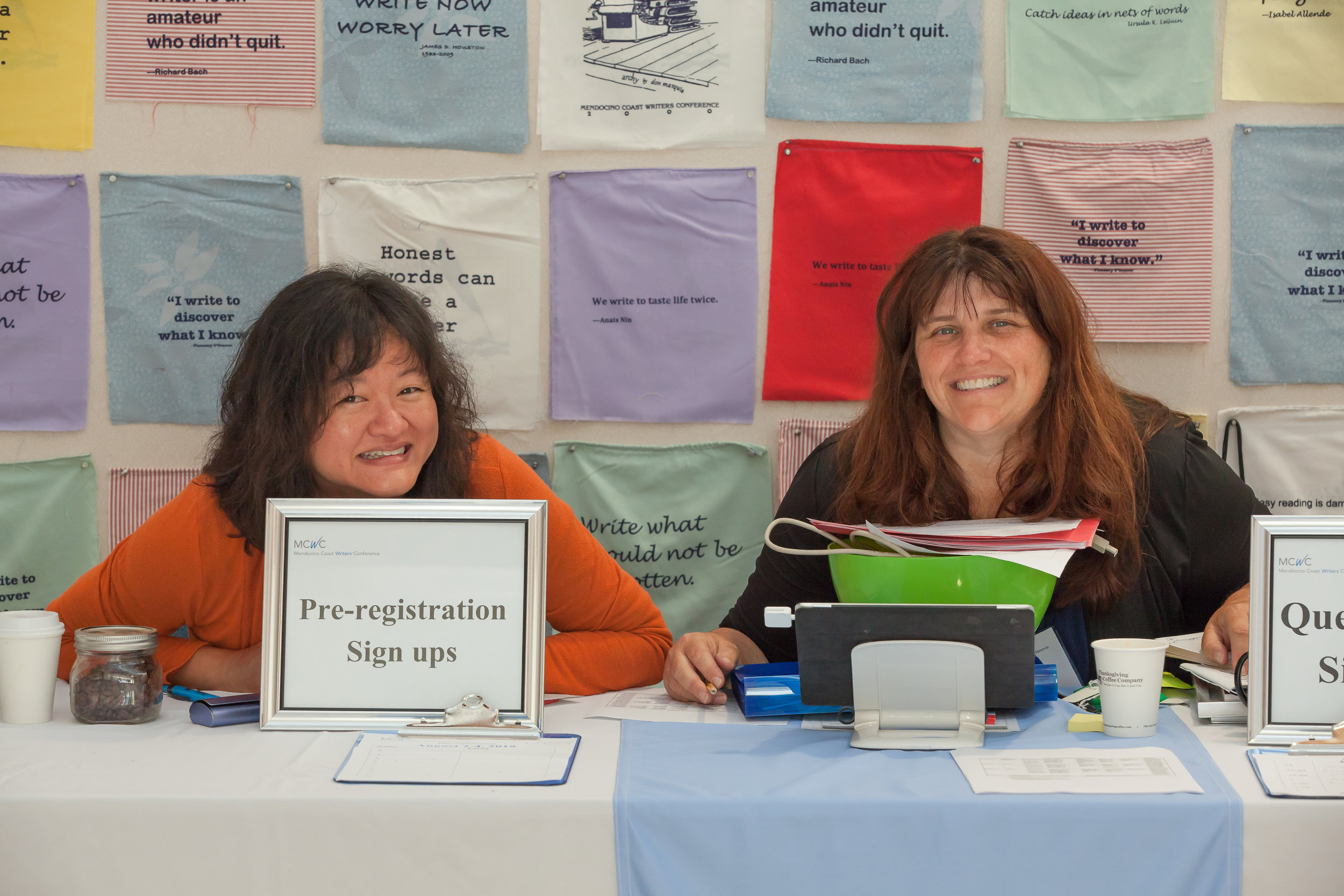 Past ED Shirin Bridges and Board Member Amie McGee manning the registration desk at MCWC 2017