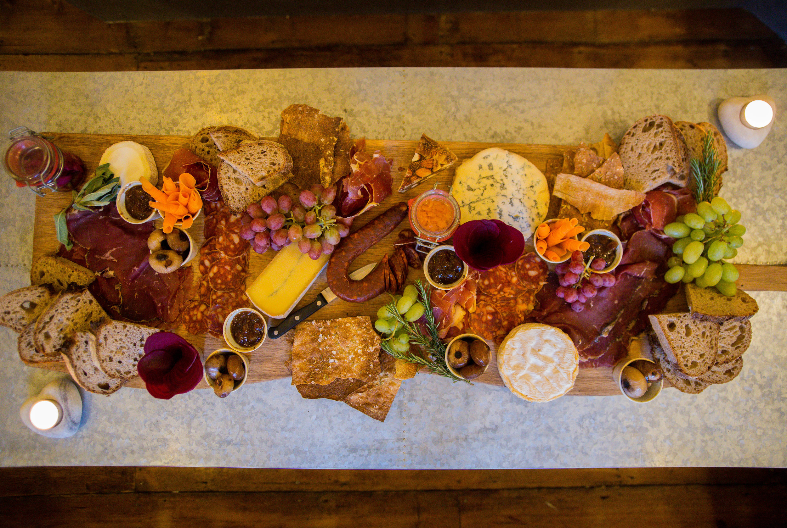 feasting - Served on our meter long boards, indulge in a selection of cured hams, salamis, chorizos, cheeses, breads, chutneys and much more...£15 per headminimum 8 peoplee