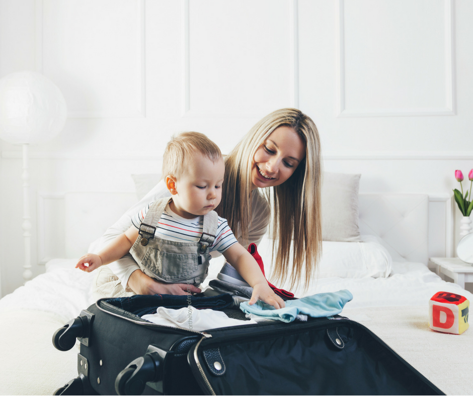 Mom packing suitcase with baby _ fortheloveofmom.org