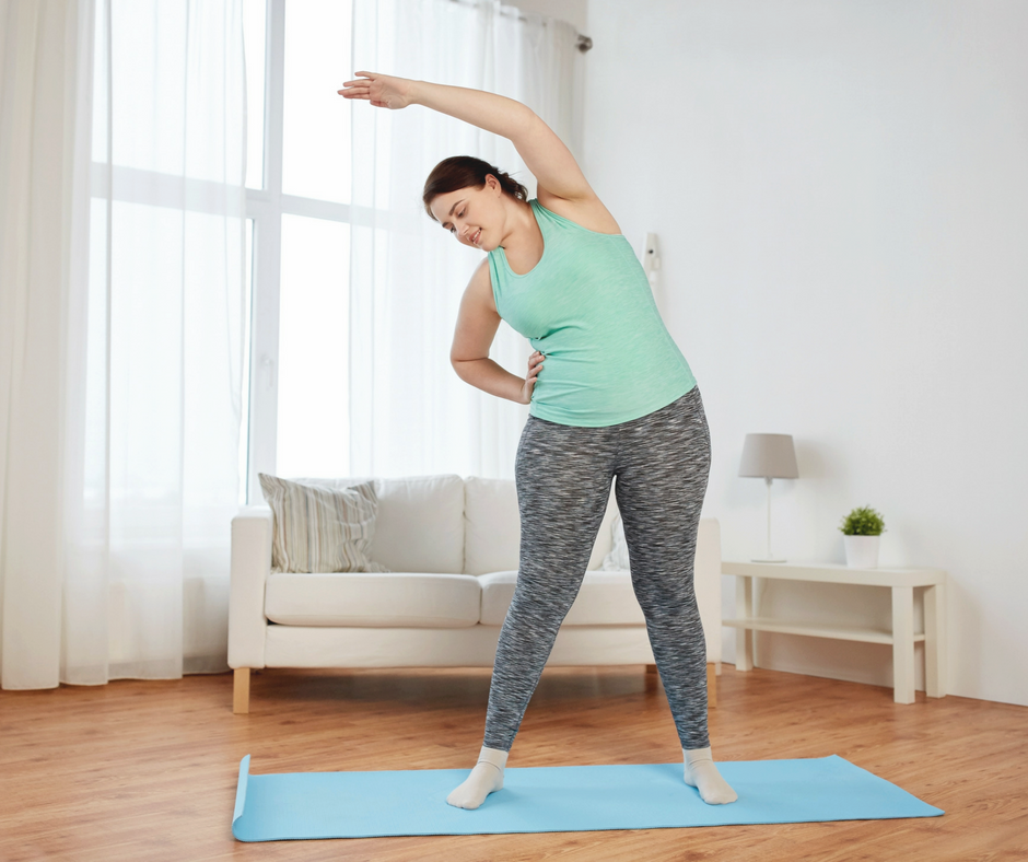 Woman Stretching in Living Room - fortheloveofmom.org