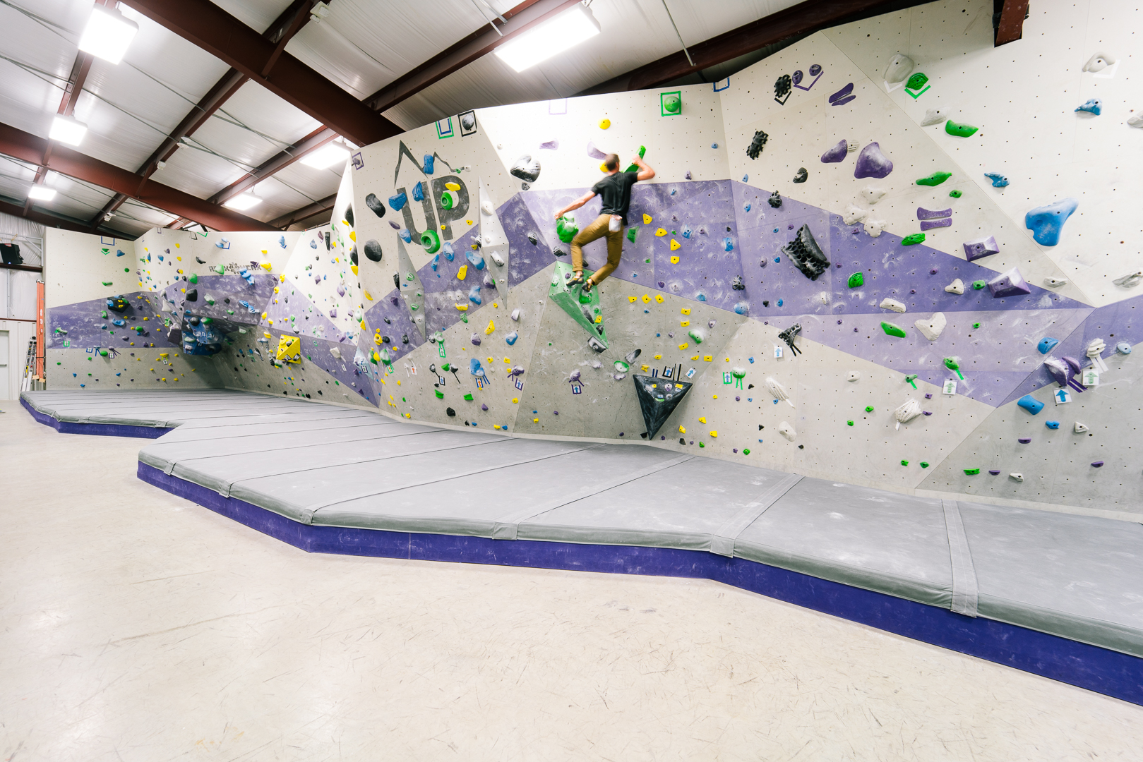 Purple and Bold - Purple and Bold – Don't want to get roped in? We have 90' of bouldering terrain to perfect your technique.