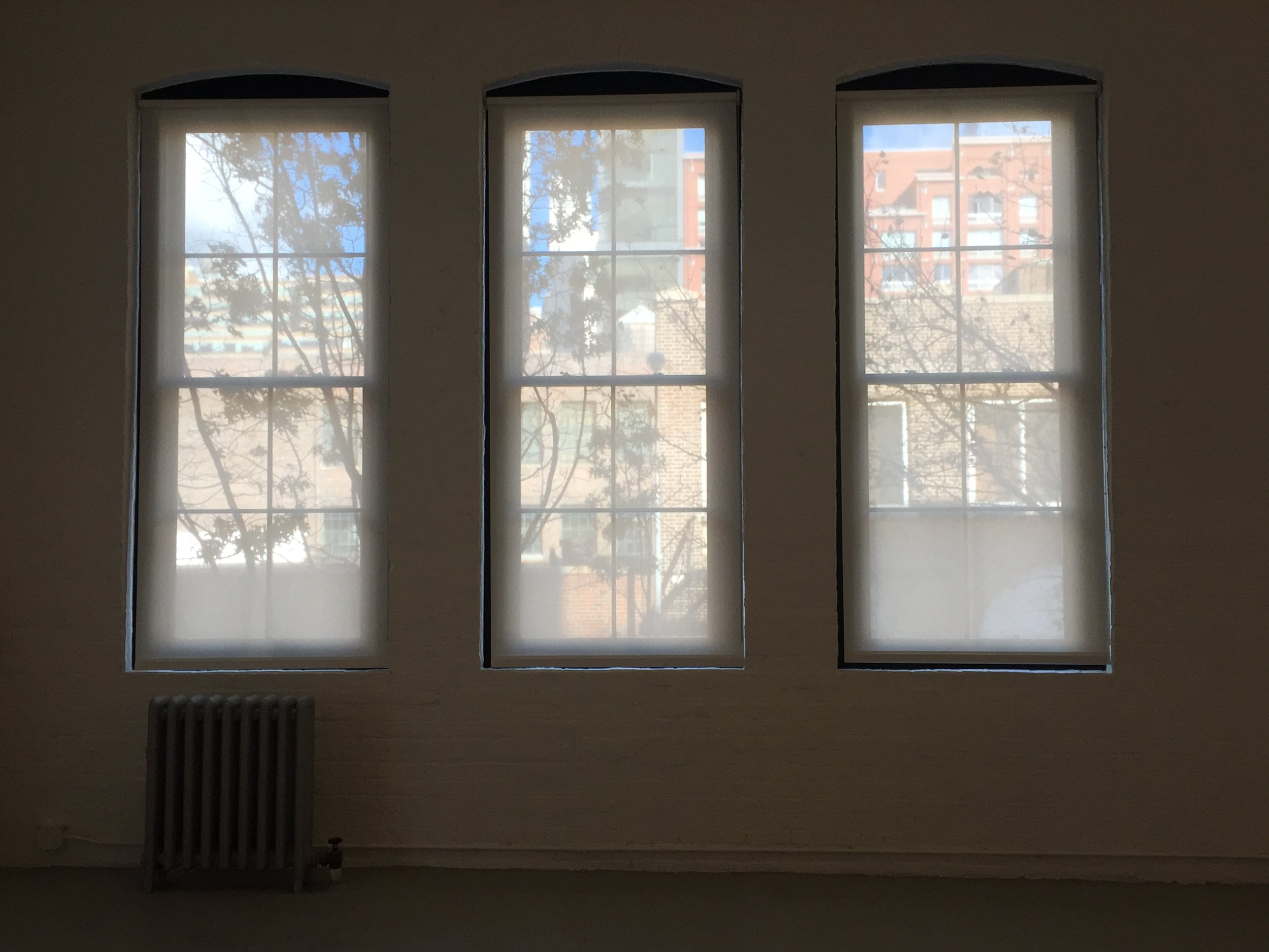 These three veiled windows in a Chelsea art gallery reminded me of a church triptych