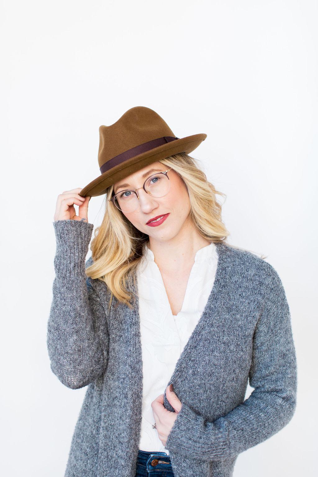winter headshot of roxanna sue photos with goorin hat