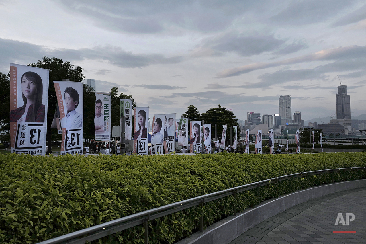 In this Aug. 28, 2016 photo, election banners line a pathway outside Hong Kong's legislature. (AP Photo/Vincent Yu)