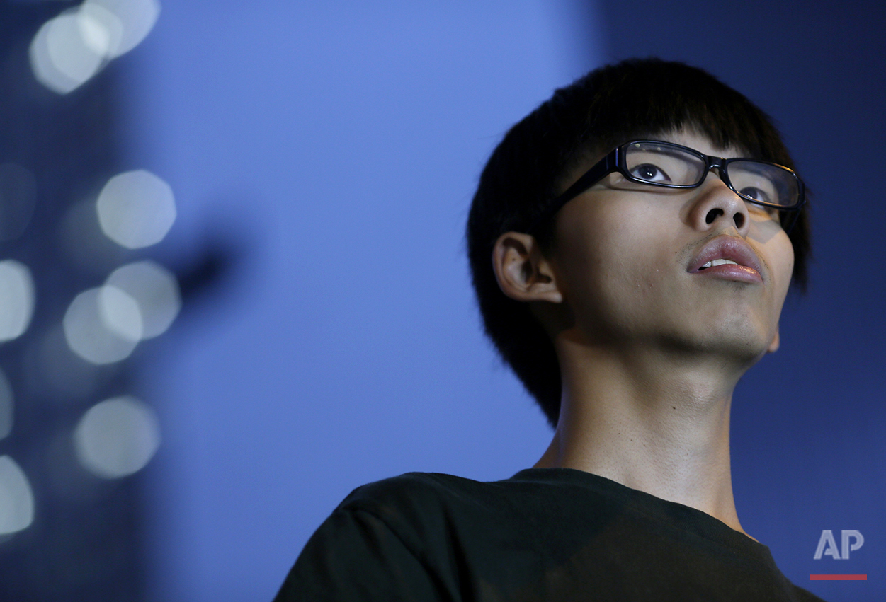 Joshua Wong, 17-year old student leader, stands on the stage during a rally in the occupied areas at Central district in Hong Kong, Thursday, Oct. 9, 2014. (AP Photo/Vincent Yu)