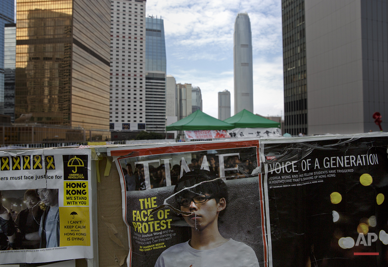 A Time magazine cover featuring Hong Kong's student Joshua Wong is seen at an occupied area by pro-democracy protesters outside the government headquarters in Hong Kong's Admiralty district, Tuesday, Oct. 21, 2014. (AP Photo/Vincent Yu)