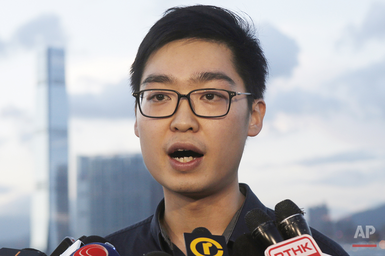 In this Tuesday, July 26, 2016, photo, Andy Chan Ho-tin of the Hong Kong National Party speaks to reporters in Hong Kong. (AP Photo/Kin Cheung)