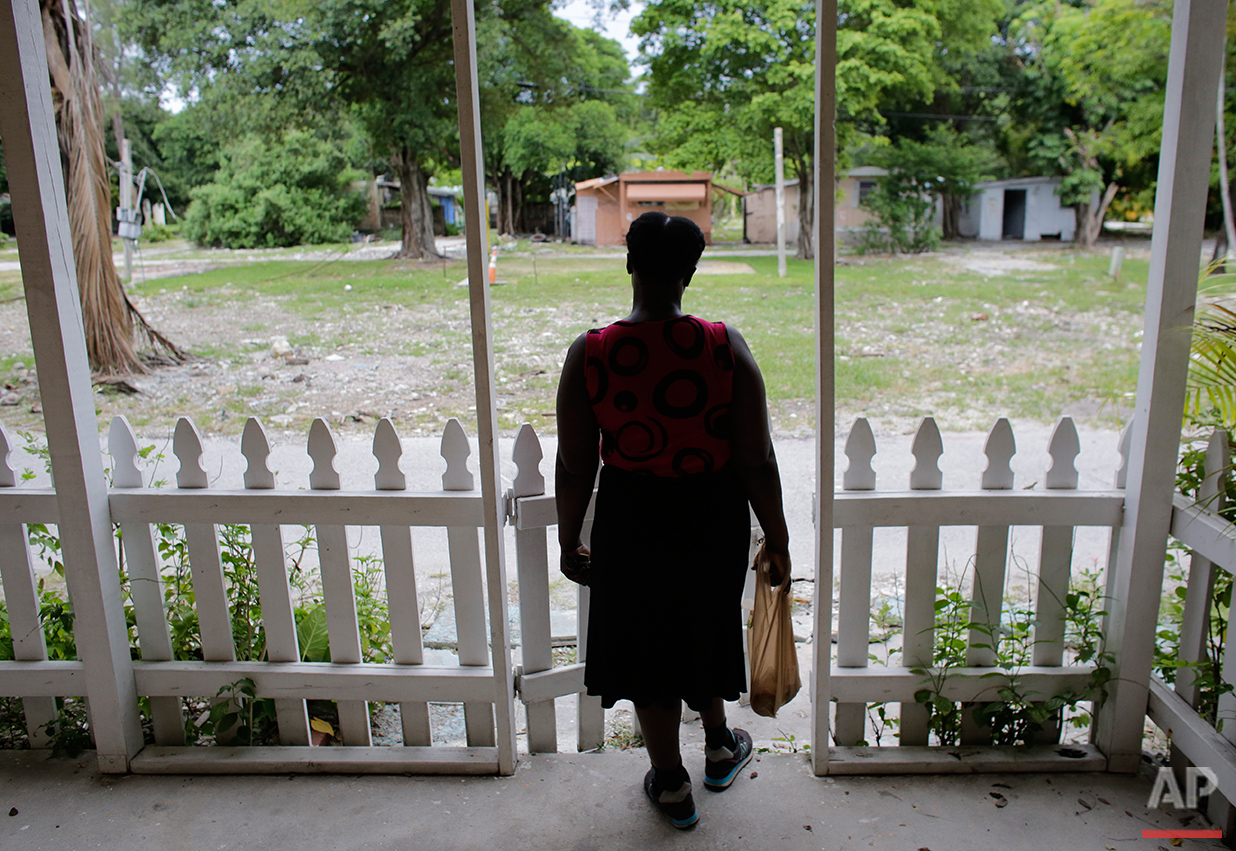 """In this Tuesday, July 12, 2016 photo, Carole Hatcher, 54, stands on the front porch of her mobile home at the Little Farm trailer park in El Portal, Fla. She called the mobile home she has owned for ten years """"a paradise"""", and had envisioned spending her golden years here. (AP Photo/Lynne Sladky)See these photos on  APImages.com"""