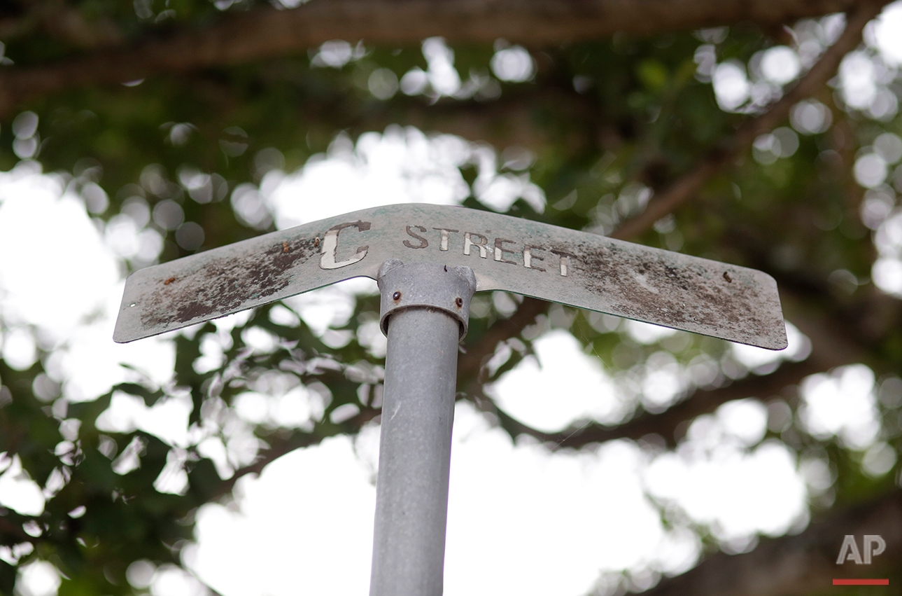 This Tuesday, July 12, 2016 photo shows a bent street sign at the Little Farm trailer park in El Portal, Fla. Residents, many of whom had owned their mobile homes in this close-knit community for years, were evicted in July after the park was purchased in 2015 by Wealthy Delight LLC. The site is now in preliminary planning for mixed use development. (AP Photo/Lynne Sladky)See these photos on  APImages.com