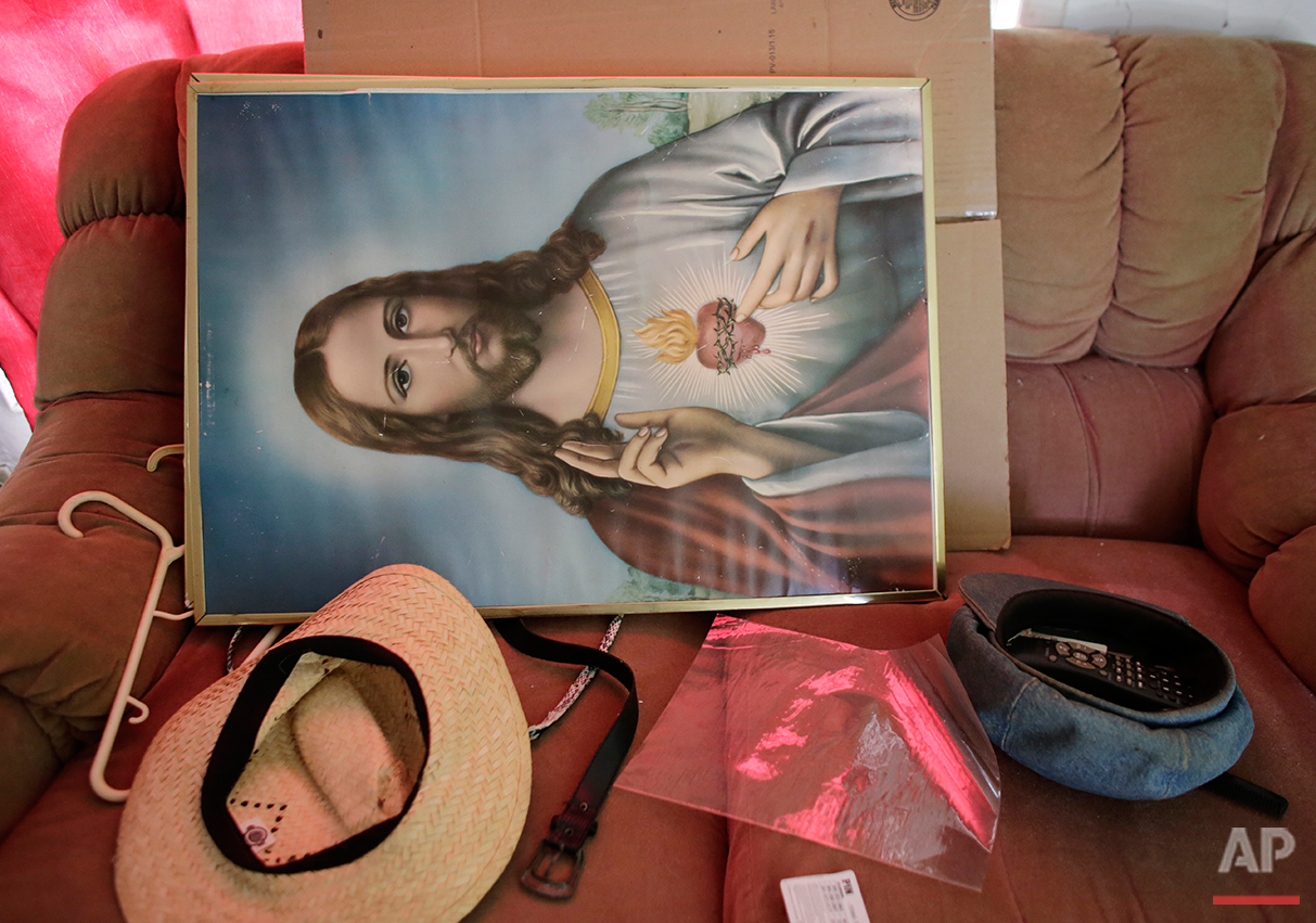 In this Saturday, July 30, 2016 photo, the personal belongings of Clairmise Blanc sit on a sofa as she packs to move from the Little Farm trailer park in El Portal, Fla. She lived here nearly ten years with her husband before he passed away, and a developer bought the neighborhood. (AP Photo/Lynne Sladky)See these photos on  APImages.com