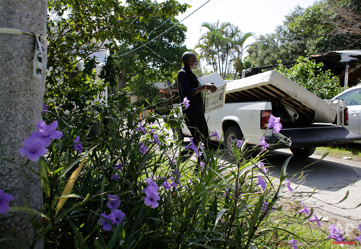 In this Saturday, July 30, 2016 photo, friends load a truck with the belongings of resident Clairmise Blanc at the Little Farm trailer park in El Portal, Fla. Blanc, who has lived in the trailer she owns for eight years, says it's important to fight for your rights, and to not push poor people around. (AP Photo/Lynne Sladky)See these photos on  APImages.com