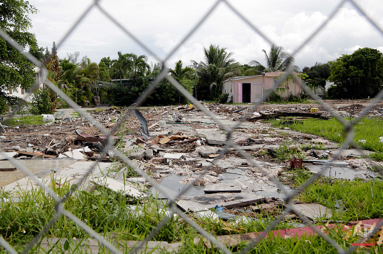 This Monday, Aug. 29, 2016 photo shows debris from a mobile home at the Little Farm trailer park in El Portal, Fla. Residents, many of whom had owned their mobile homes in this close-knit community for years, were evicted in July after the park was purchased in 2015 by Wealthy Delight LLC. The site will be razed and is now in preliminary planning for mixed use development. (AP Photo/Lynne Sladky)See these photos on  APImages.com