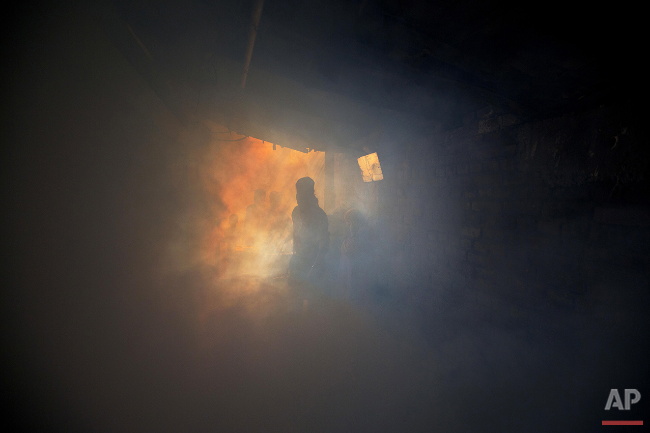 A municipal worker fumigates an alley in an impoverished area to prevent the spread of mosquito-borne diseases in New Delhi, Friday, Sept. 2, 2016. Scientists trying to predict the future path of Zika say that 2.6 billion people living in parts of Asia and Africa could be at risk of infection, based on a new analysis of travel, climate and mosquito patterns in those regions. Some of the most vulnerable countries include India, China, the Philippines, Indonesia, Nigeria, Vietnam, Pakistan and Bangladesh, according to the research. (AP Photo/Manish Swarup)