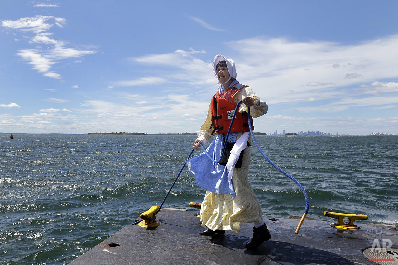In this Aug. 17, 2016 photo, Sally Snowman, the keeper of Boston Light, unties a dock line at Little Brewster Island in Boston Harbor. (AP Photo/Elise Amendola)See these photos on  APImages.com