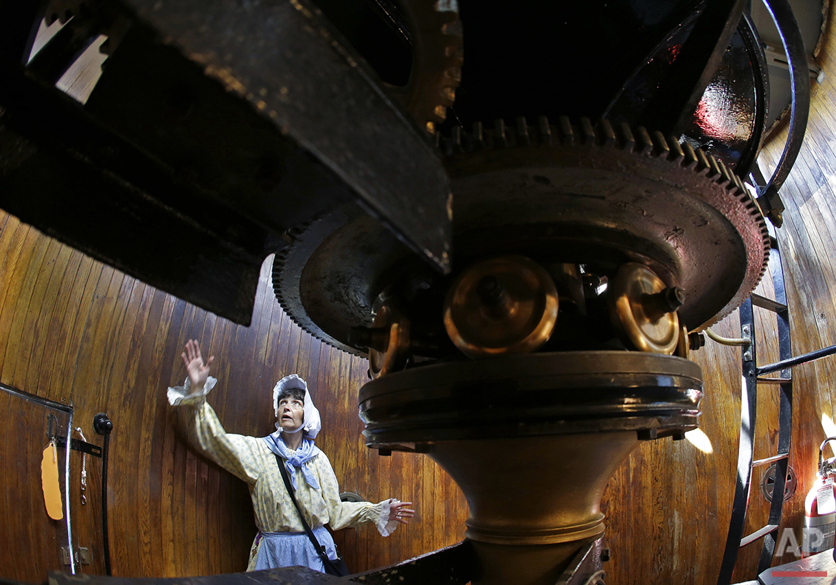 In this Aug. 17, 2016 photo, Sally Snowman, the keeper of Boston Light, gives a tour of the gear room inside the lighthouse on Little Brewster Island in Boston Harbor. (AP Photo/Elise Amendola)See these photos on  APImages.com