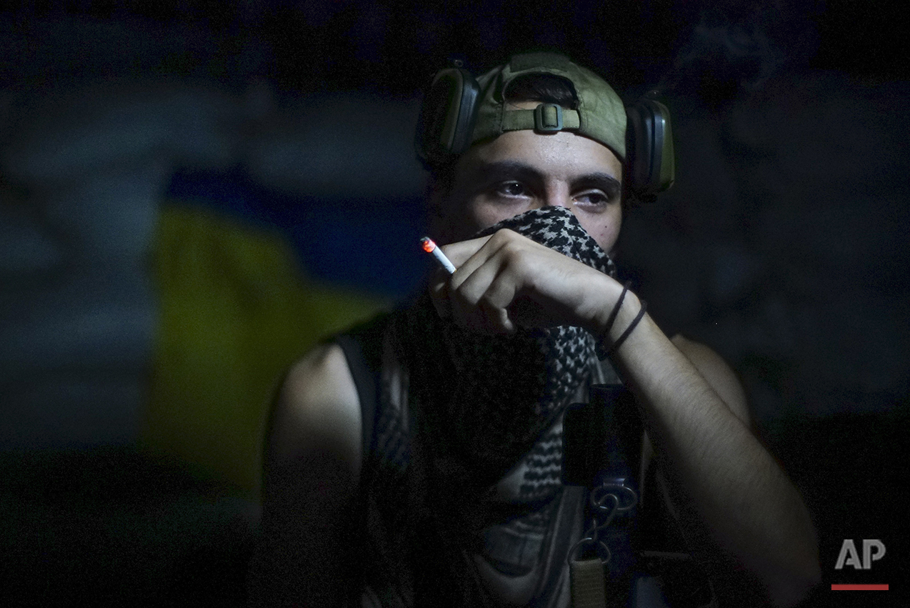 In this photo taken on Friday, Aug. 26, 2016, a Ukrainian soldier smokes in the village of Marinka, near Donetsk, eastern Ukraine. More than 9,500 people have been killed in the fighting that began in April 2014, according to United Nations figures, but despite the carnage or the weariness of those inflicting it, there's little expectation it will actually stop anytime soon. (AP Photo/Max Black)See these photos on  APImages.com