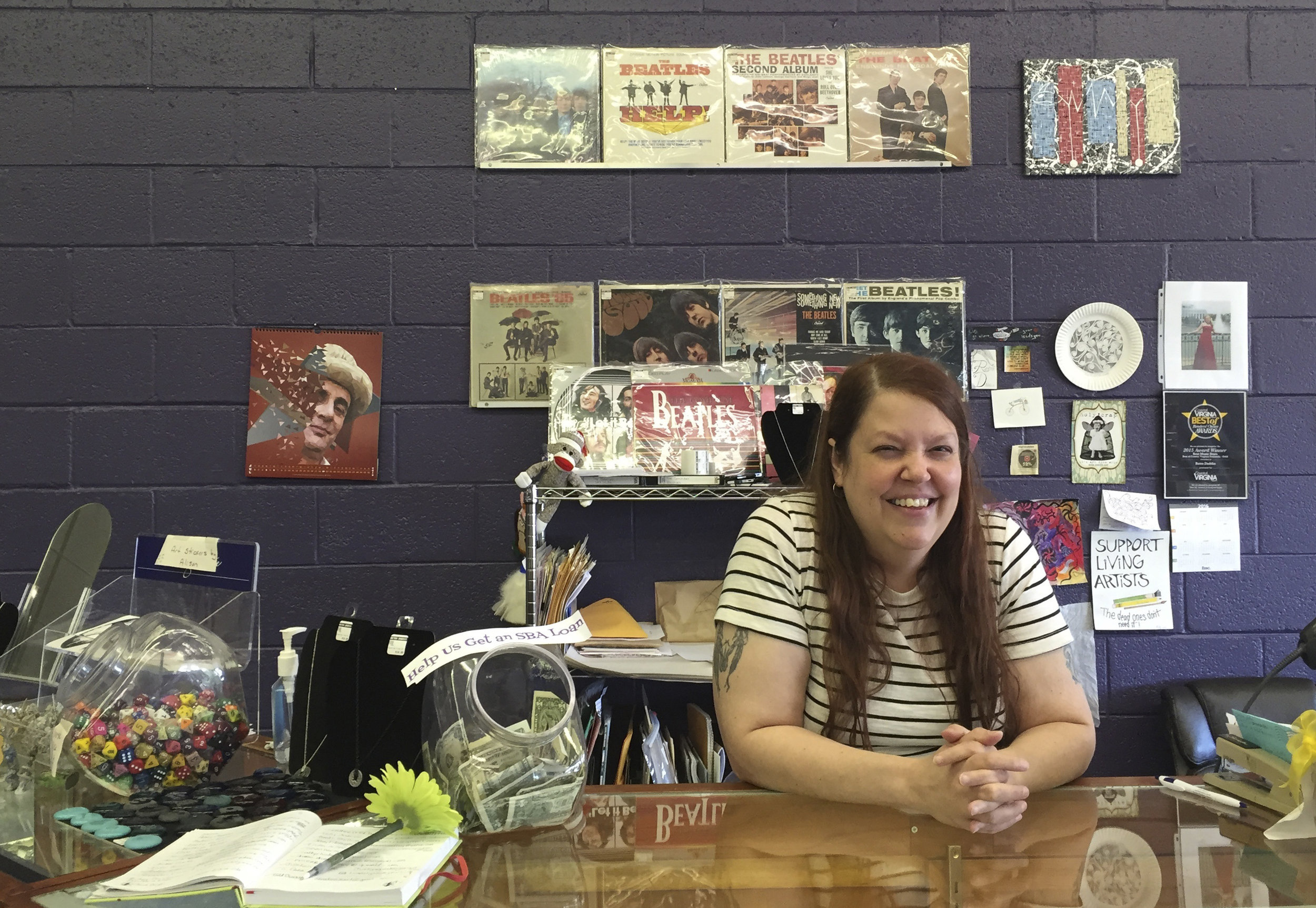 Jen Thurman, owner of the record store Retro Daddio poses for a photo at her store in Williamsburg, Va. Thursday July 28, 2016. Thurman says John Hinckley comes in about once a month and always buys something, whether it's a book about The Who or a 45 rpm record. Life for the man who tried to assassinate President Ronald Reagan 35 years ago has progressively become more normal as he prepares to permanently live with his mother. (AP Photo/Ben Finley)