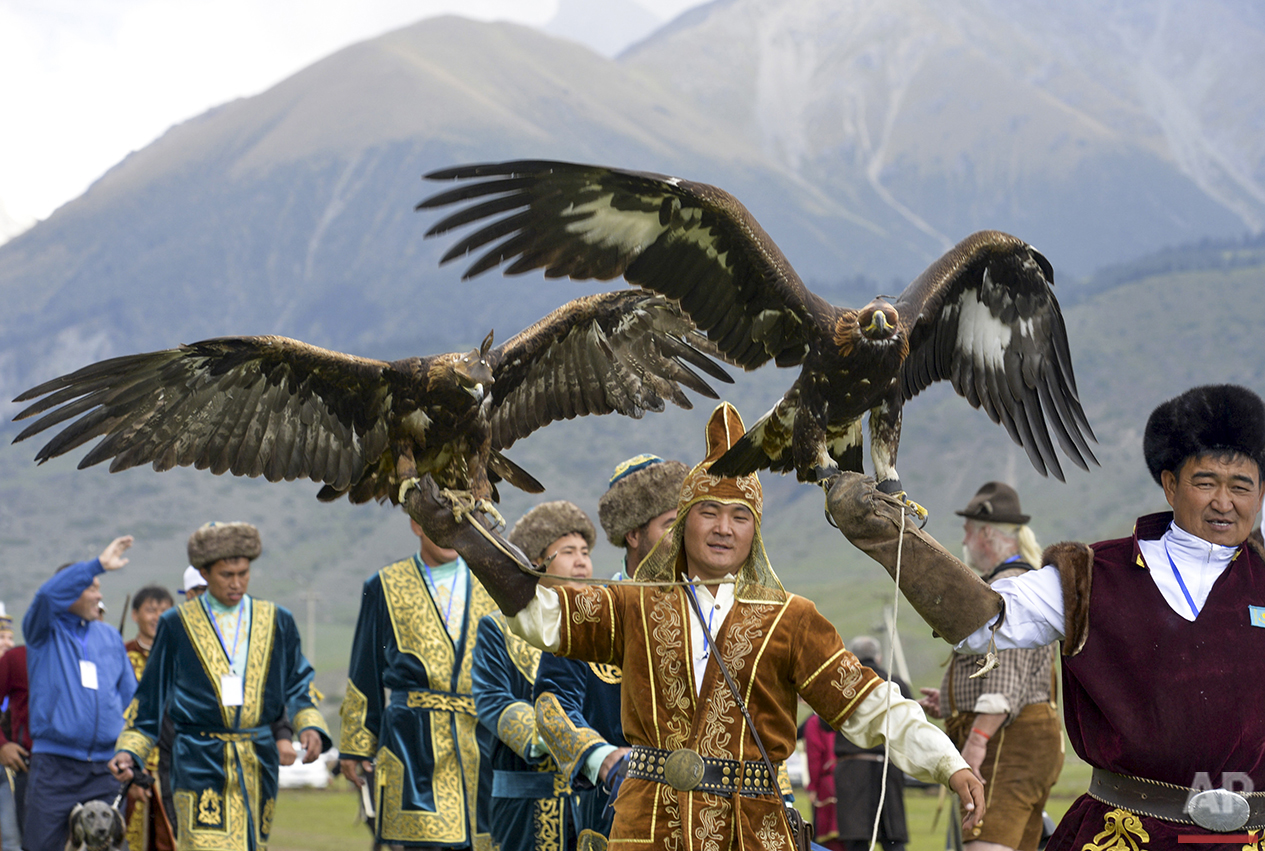 Participants hold golden eagles for a competition during the second World Nomad Games at Issyk Kul lake in Cholpon-Ata, Kyrgyzstan on Sunday, Sept. 4, 2016. The games bring together athletes from 40 countries, including Russia and the United States. (AP Photo/Vladimir Voronin)