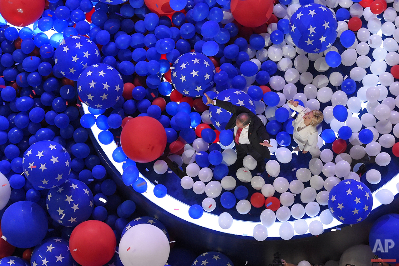 Democratic presidential nominee Hillary Clinton and her running mate Democratic vice presidential nominee Sen. Tim Kaine, D-Va., walk through a sea of balloons at the conclusion of the Democratic National Convention in Philadelphia, Friday, July 29, 2016. (AP Photo/Mark J. Terrill)