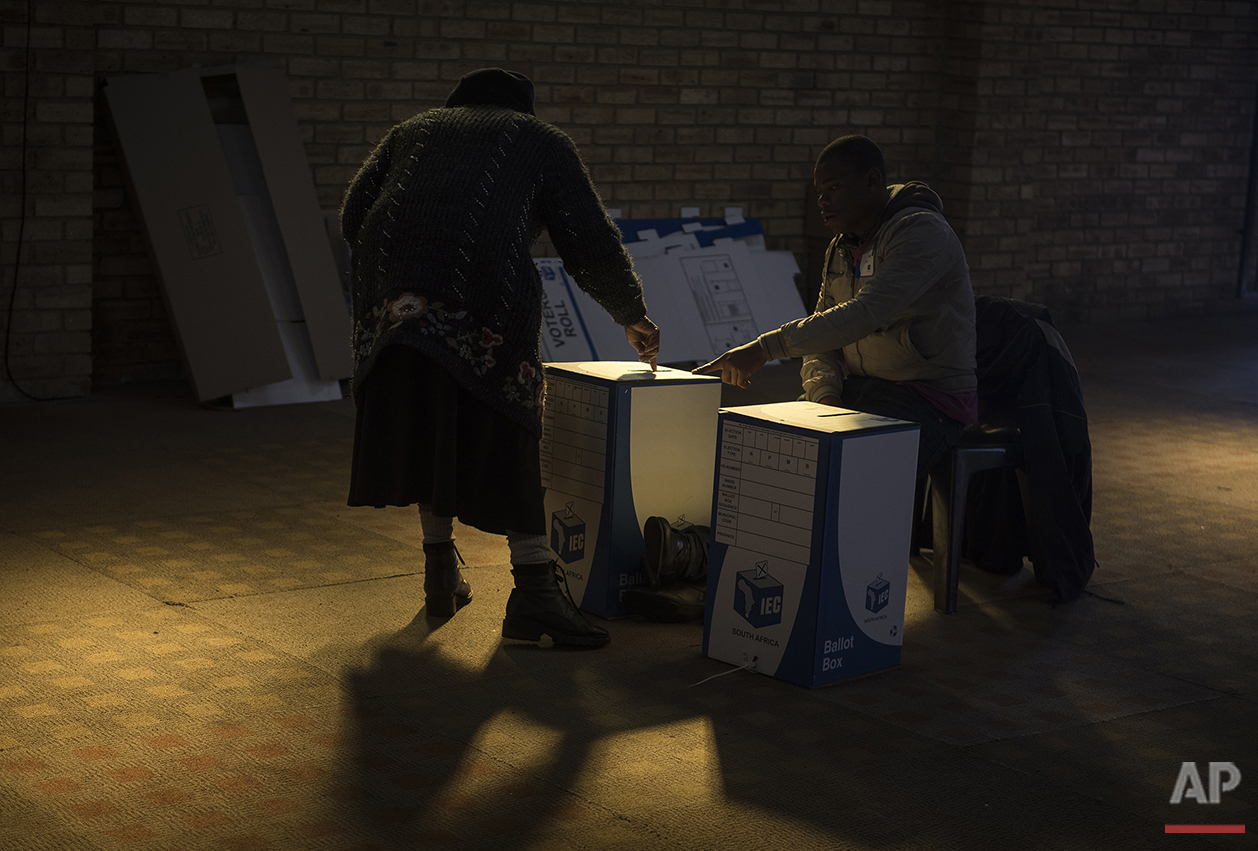 A woman casts her vote at a polling station in Soweto, South Africa, Wednesday Aug. 3, 2016. South Africans are voting in municipal elections in which the ruling African National Congress seeks to retain control of key metropolitan areas despite a vigorous challenge from opposition parties. (AP Photo/Shiraaz Mohamed)