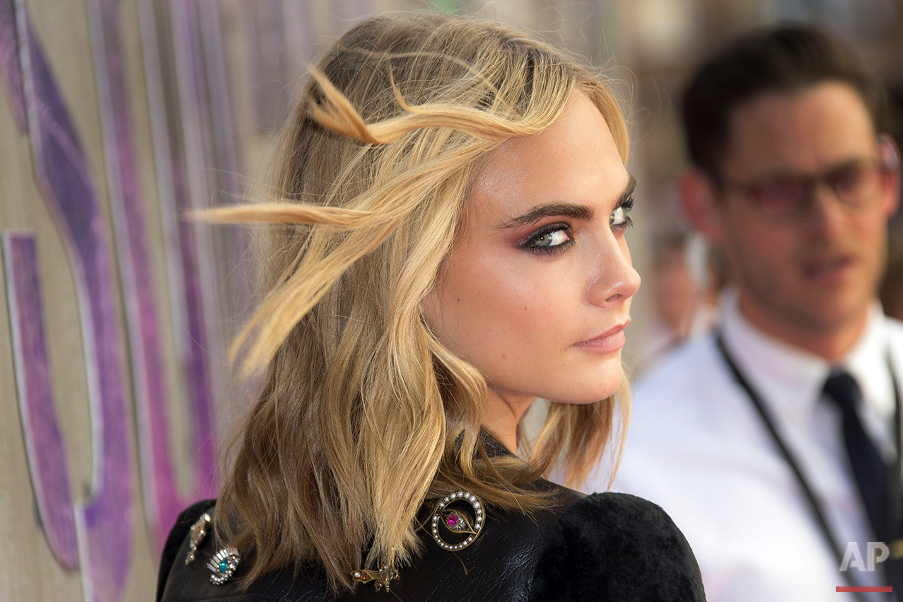 """Model and actress Cara Delevingne poses for photographers upon arrival at the European Premiere of """"Suicide Squad,"""" at a central London cinema in Leicester Square, Wednesday, Aug 3, 2016. (AP Photo/Joel Ryan)"""