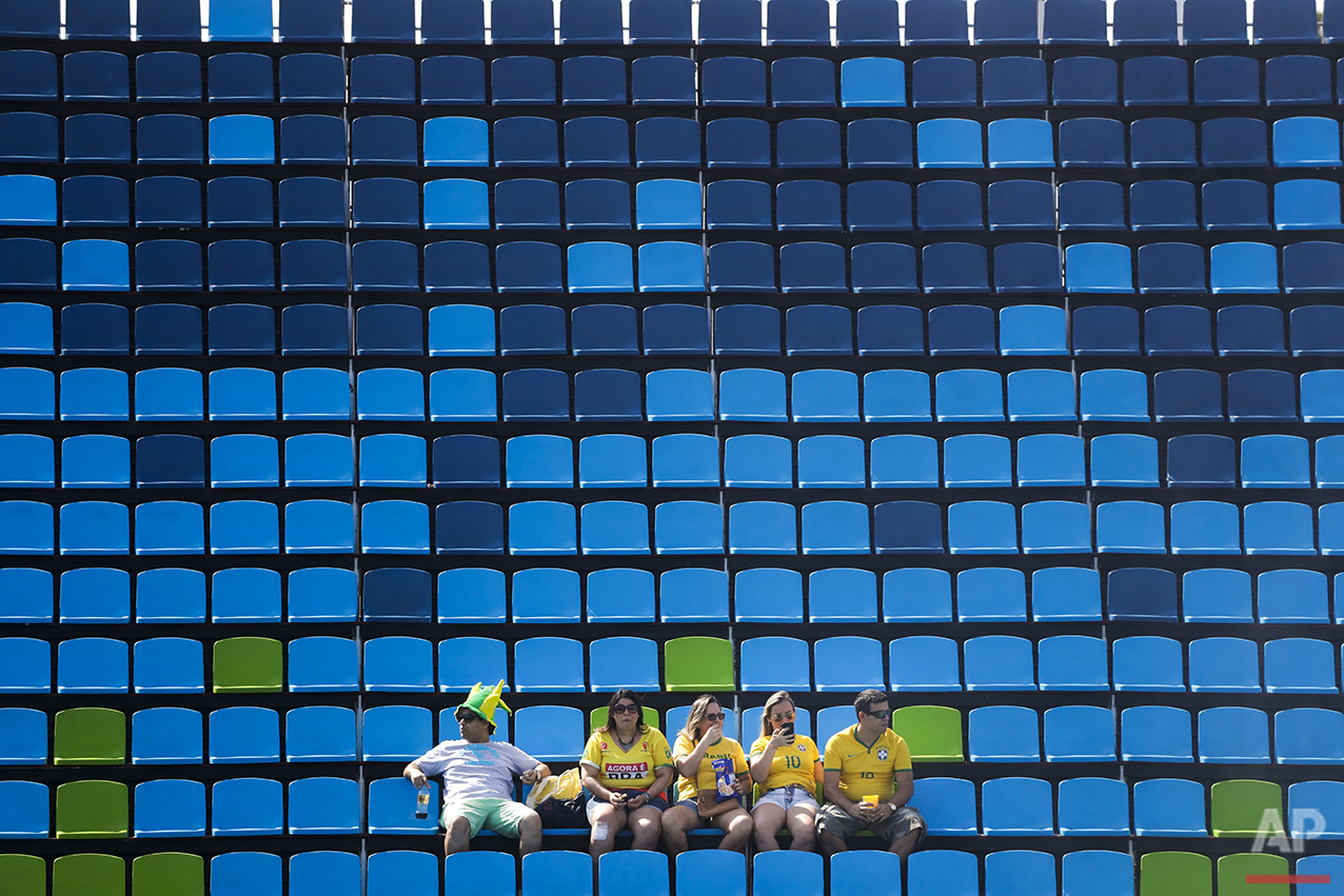 A small group of Brazilian fans attend a women's field hockey match between South Korea and New Zealand at the 2016 Summer Olympics in Rio de Janeiro, Brazil, Sunday, Aug. 7, 2016. (AP Photo/Jae C. Hong)