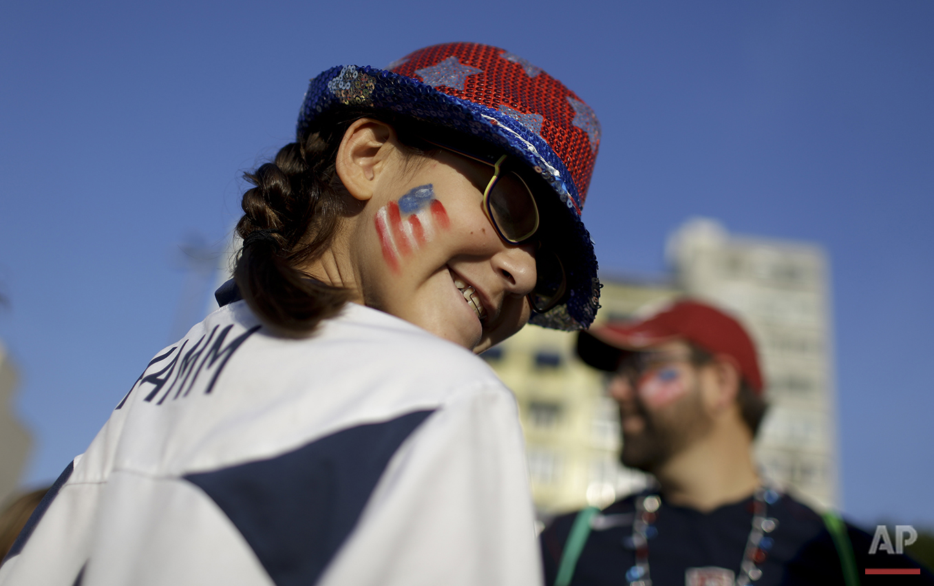A fan from the United States smiles as she walks towards the Maracana Stadium ahead of the opening ceremony for the 2016 Summer Olympics in Rio de Janeiro, Brazil, Friday, Aug. 5, 2016. (AP Photo/Natacha Pisarenko)