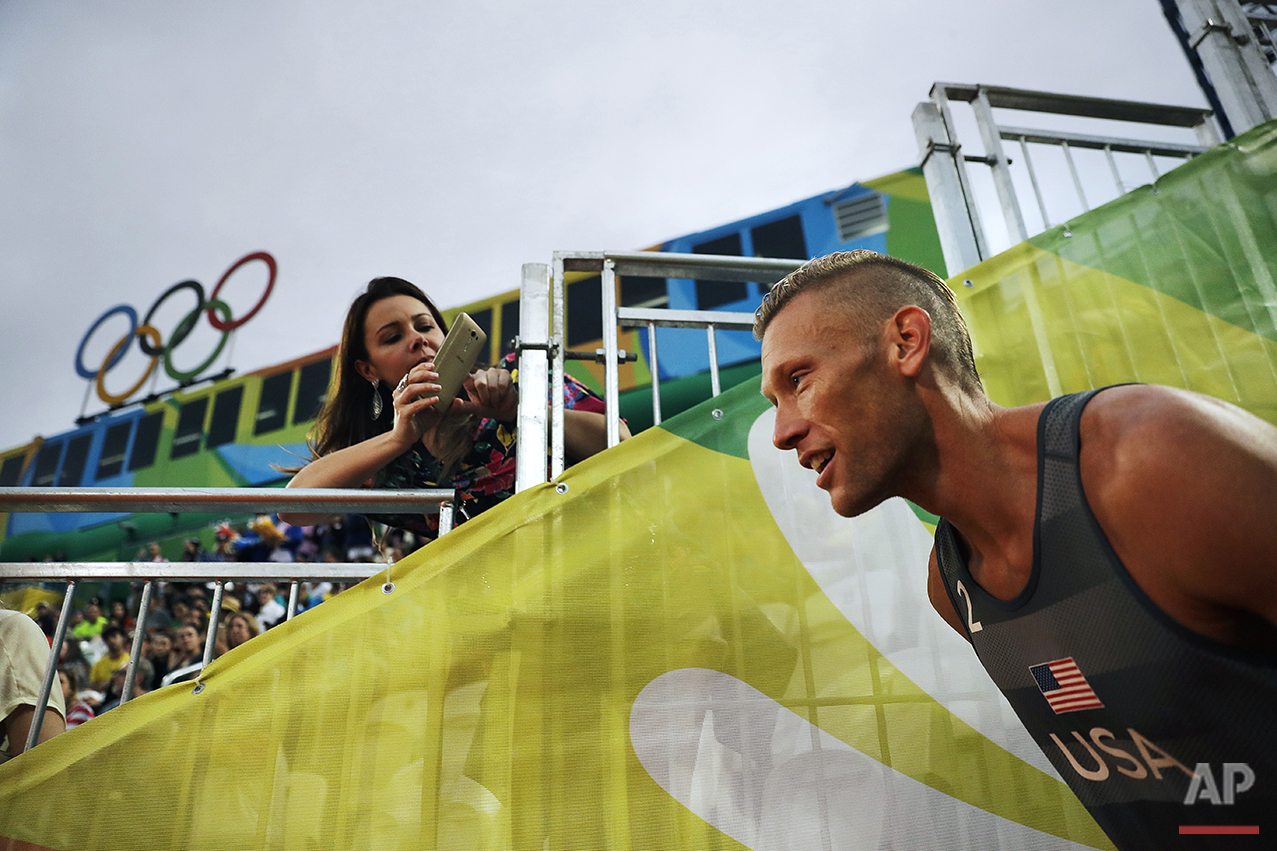 Casey Patterson, of the United States, takes the court as he's introduced to the crowd for a men's beach volleyball match against Austria at the 2016 Summer Olympics in Rio de Janeiro, Brazil, Monday, Aug. 8, 2016. (AP Photo/David Goldman)