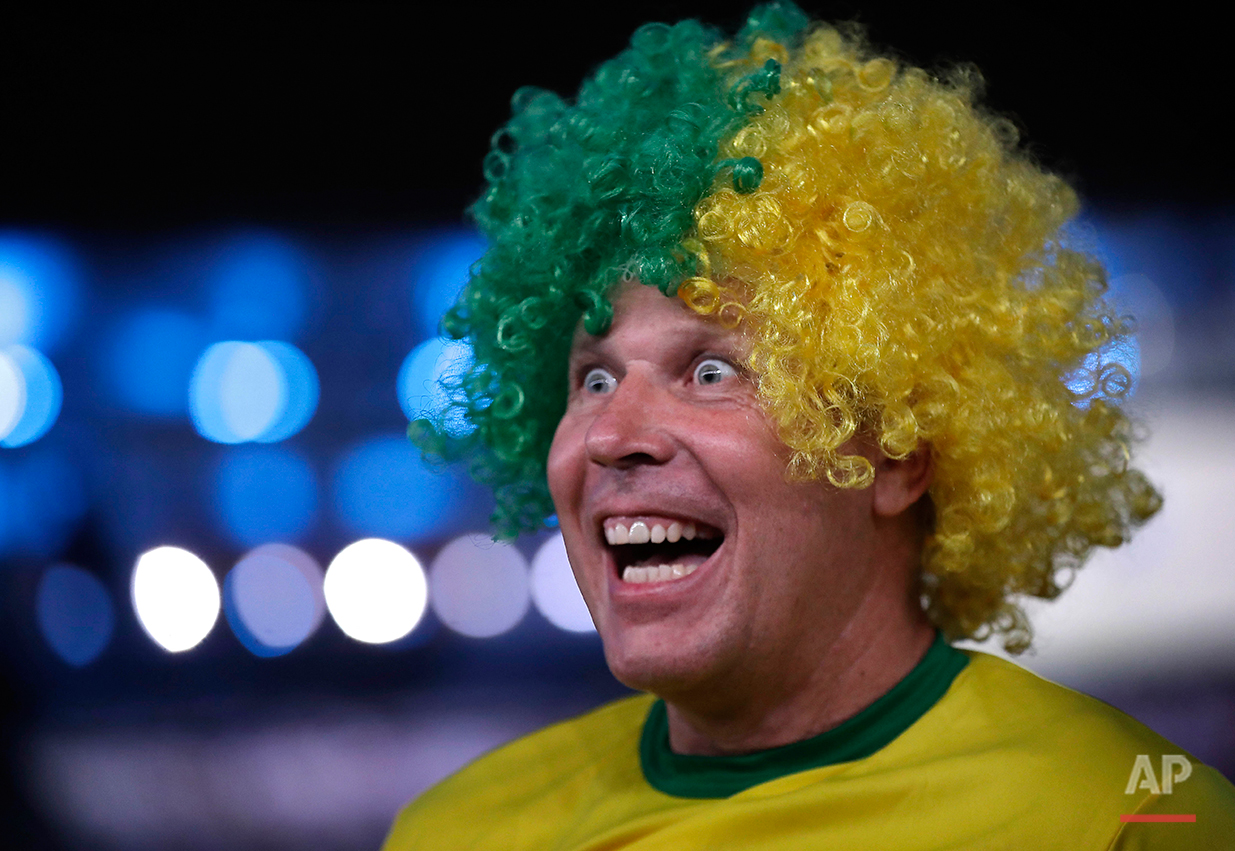 Giorgio Licitra of Italy enjoys the festivities at the opening ceremony for the 2016 Summer Olympics in Rio de Janeiro, Brazil, Friday, Aug. 5, 2016. (AP Photo/Robert F. Bukaty)