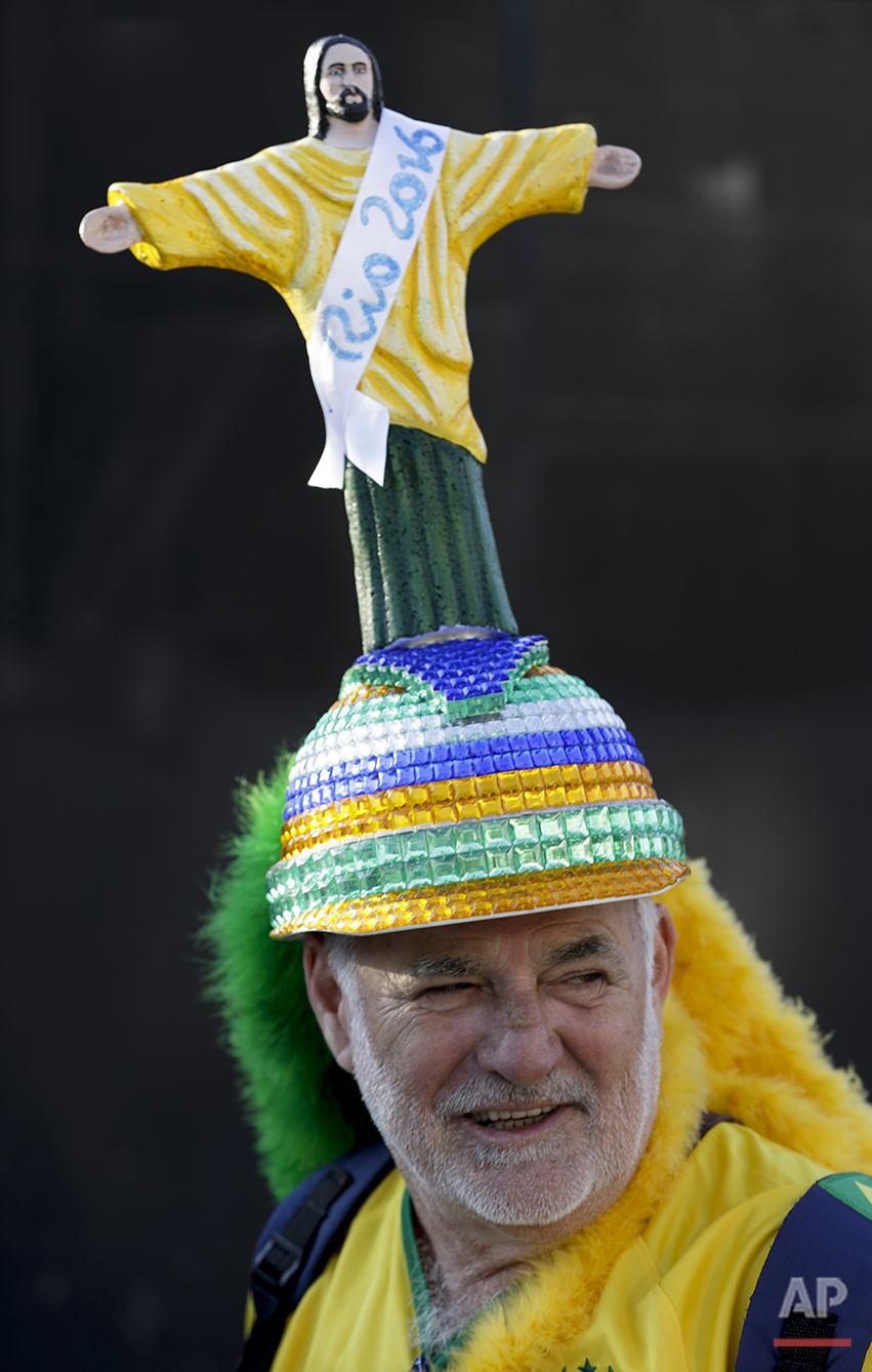 Amadeo Russi wears a hat with an image of Christ the Redeemer as he waits to enter Maracana Stadium before the opening ceremony for the 2016 Summer Olympics in Rio de Janeiro, Brazil, Friday, Aug. 5, 2016. (AP Photo/Gregory Bull)