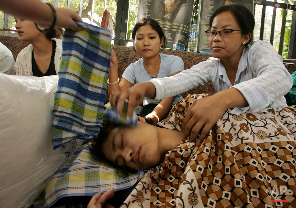 In this Oct. 5, 2006 file photo, Irom Sharmila is attended to by supporters at a protest to demand the repeal of the Armed Forces Special Powers Act in her home state of Manipur, in New Delhi, India. (AP Photo/Gurinder Osan)