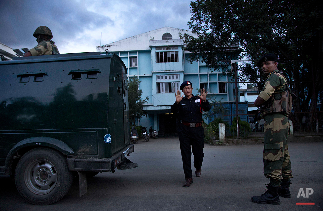 A security officer gestures as he objects to taking photographs outside the Jawaharlal Nehru hospital where Indian activist Irom Sharmila has been kept in judicial custody in Imphal, northeastern Manipur state, India, Monday, Aug.8, 2016. The 44-year-old activist who has been on a hunger strike for nearly 16 years to protest alleged brutality by India's military is expected to end her fast on Aug. 9. (AP Photo/Anupam Nath)