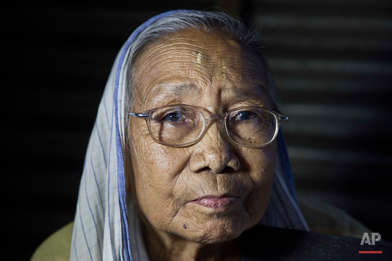 Irom Sakhi Devi, 84, mother of Indian activist Irom Sharmila, looks on as media persons interview her at her home in Imphal, northeastern Manipur state, India, Monday, Aug.8, 2016. Sharmila, the 44-year-old activist who has been on a hunger strike for nearly 16 years to protest alleged brutality by India's military is expected to end her fast on  Tuesday, Aug. 9. (AP Photo/Anupam Nath)