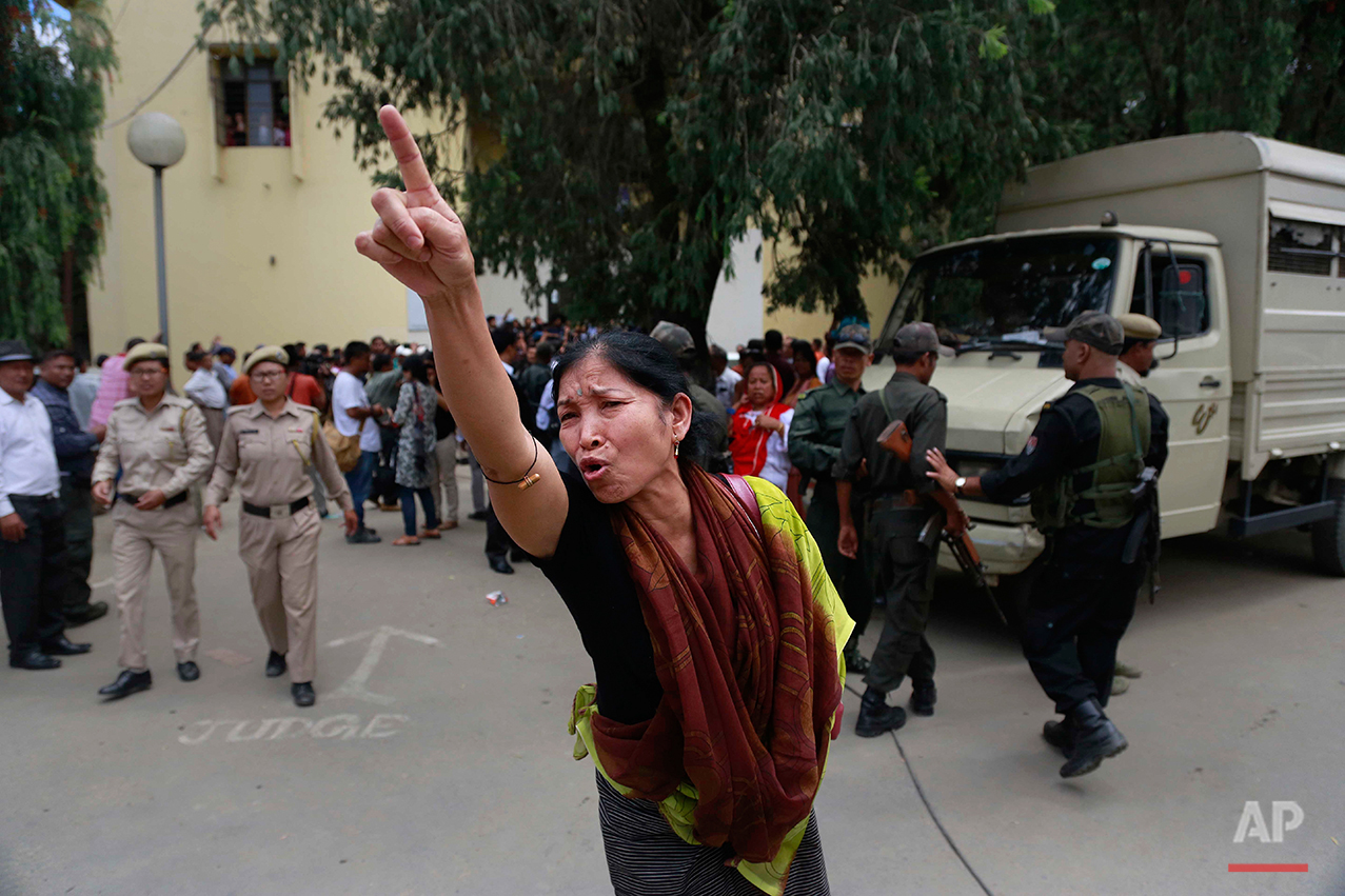 A Manipuri human rights activist shouts against the decision of Irom Sharmila to break her fast, in Imphal, north-eastern Indian state of Manipur, India, Monday, Aug. 9, 2016. The 44-year-old activist who has been on a hunger strike for nearly 16 years to protest against alleged brutality by India's military, is expected to end her fast today. (AP Photo/Anupam Nath)