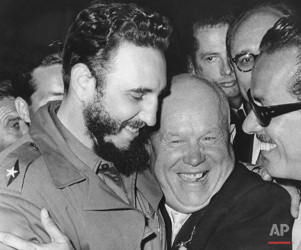 In a Sept. 20, 1960 photo, Cuban leader Fidel Castro, left, and Soviet leader Nikita Khrushchev hug at the United Nations. As Castro celebrates his 90th birthday on Aug. 13, 2016, hundreds of thousands of Cubans are running private businesses, buying and selling their homes and cars and checking the internet on imported cell phones. Tens of thousands of Cubans are emigrating to the United States, hollowing out the ranks of highly educated professionals. (AP Photo/Marty Lederhandler)