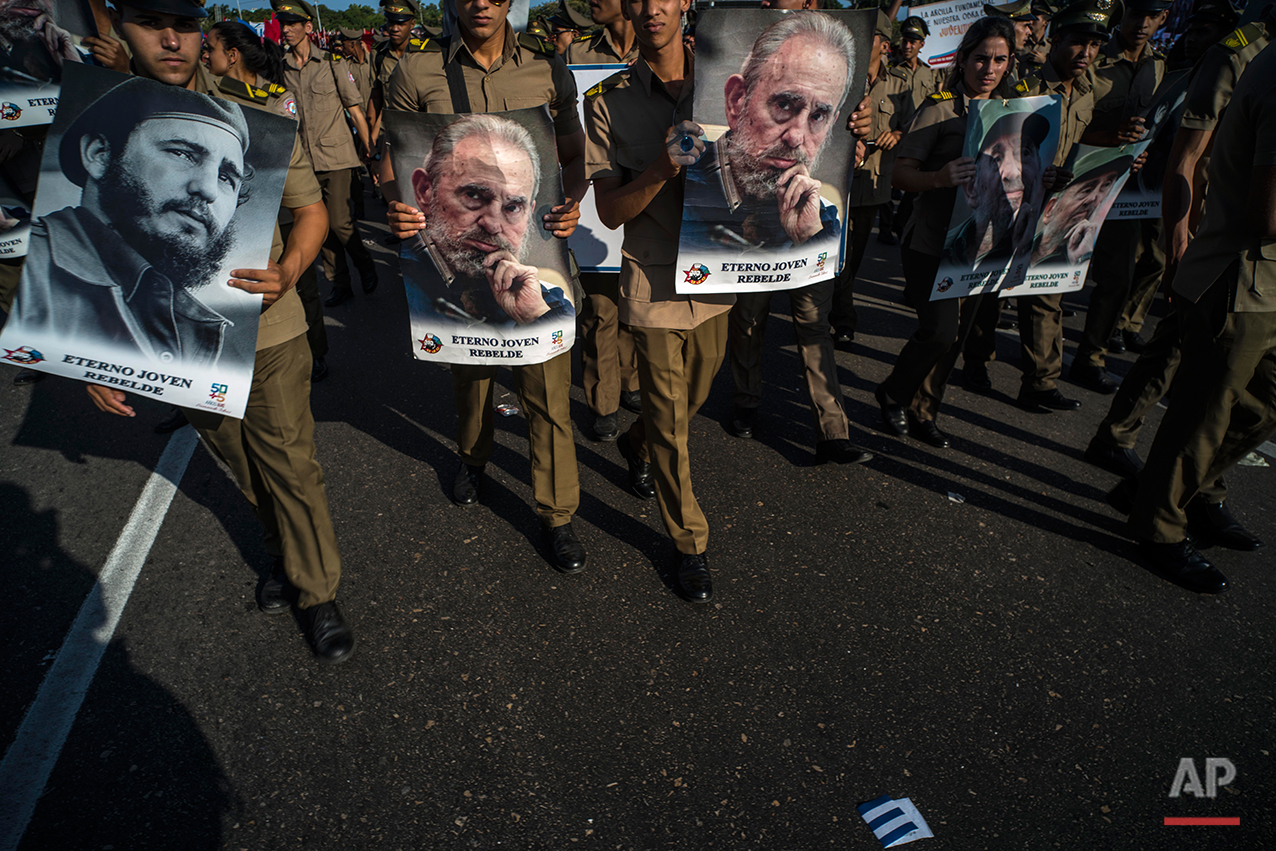 In this May 1, 2016 photo, soldiers with images of Cuban leader Fidel Castro march during the May Day parade at Revolution Square, in Havana, Cuba. Thousands of people converged on the square for the traditional May Day march. Fidel Castro will turn 90 on Aug. 13. (AP Photo/Ramon Espinosa)