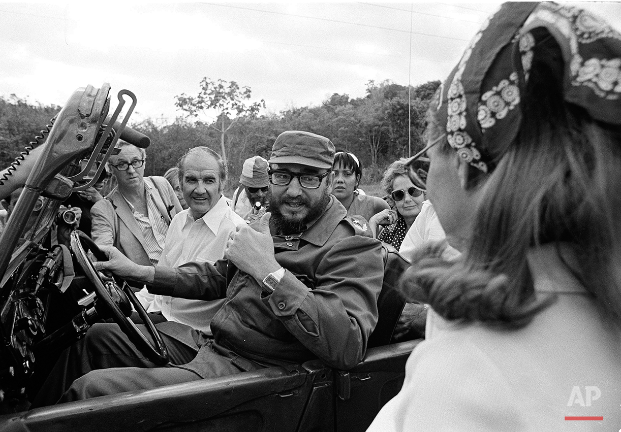 South Dakota Senator George McGovern goes for a jeep ride with Cuban Premier Fidel Castro, behind the wheel, during the senator's visit to Cuba, May 8, 1975.  (AP Photo/Charles Tasnadi)
