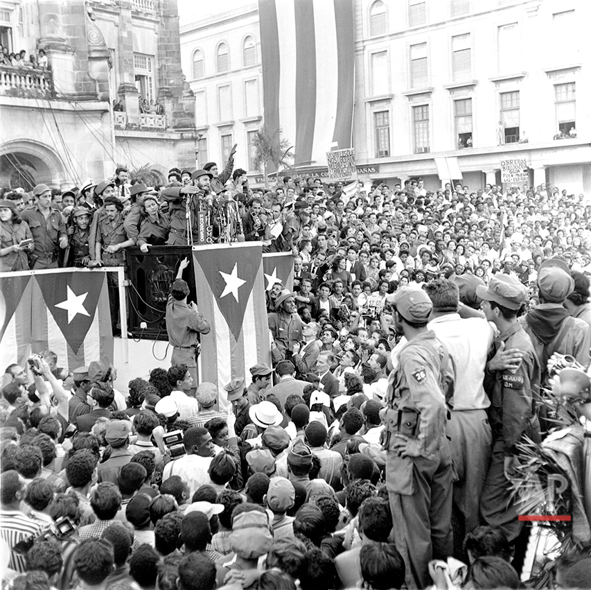 Fidel Castro gestures as he addresses a crowd of several hundred thousand persons gathered in the park in front of the presidential palace in Havana, Cuba, in Jan. 1959. (AP Photo/Harold Valentine)