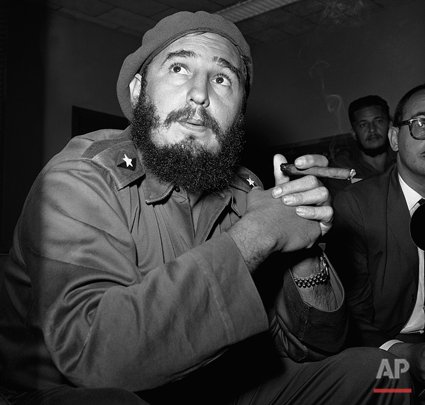 In this June 14, 1961 photo, Prime Minister Fidel Castro holds a cigar during a news conference in Havana, Cuba. For over half a century, the U.S. government tried many schemes to overthrow the Castro regime: poisonous cigars, an exploding seashell, the secret Twitter-like service in Cuba. U.S. President Barack Obama said Wednesday, Dec. 17, 2014 the United States will re-establish diplomatic ties with Cuba and bring change to the longstanding trade embargo. But it was unclear if all secret operations would cease. (AP Photo/RHS)