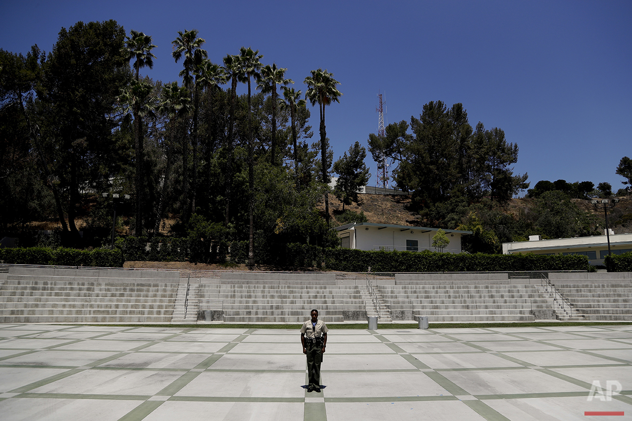 In this Tuesday, July 19, 2016 photo, Los Angeles County sheriff's deputy recruit Renata Phillip stands still while waiting for her training to start at the Biscailuz Regional Training Center in Monterey Park, Calif. (AP Photo/Jae C. Hong)