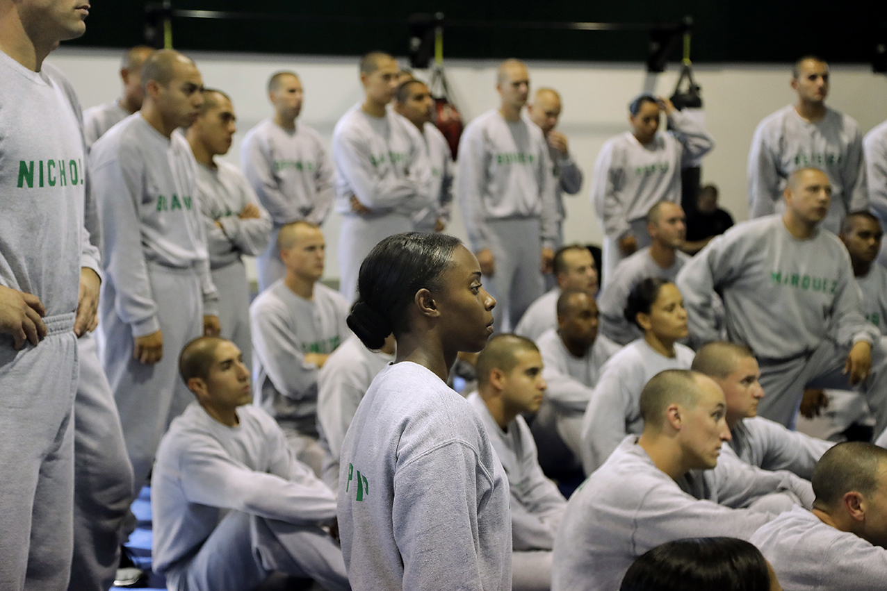 In this Friday, July 29, 2016 photo, Los Angeles County sheriff's deputy recruit Renata Phillip, center, listens to an instructor during a defensive tactics class at the Biscailuz Regional Training Center in Monterey Park, Calif. Phillip stands out from her recruit class, made up of mostly white and Hispanic men and women. Only about 4 percent of her class are black women, said Capt. Scott Gage, who's in charge of training at the Los Angeles County Sheriff's Department. (AP Photo/Jae C. Hong)