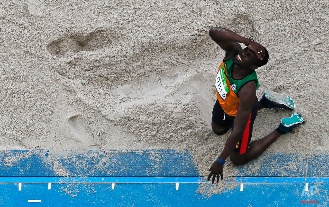 Guyana's Troy Doris reacts to a jump in the triple jump finals during the athletics competitions of the 2016 Summer Olympics at the Olympic stadium in Rio de Janeiro, Brazil, Tuesday, Aug. 16, 2016. (AP Photo/Morry Gash)